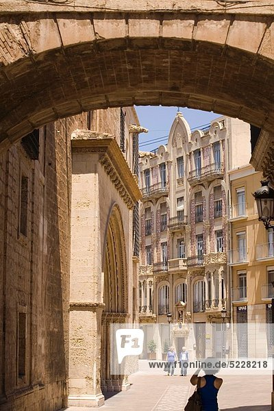 At left cathedral  On background Punt de Ganxo art nouveau house  Valencia  Spain.