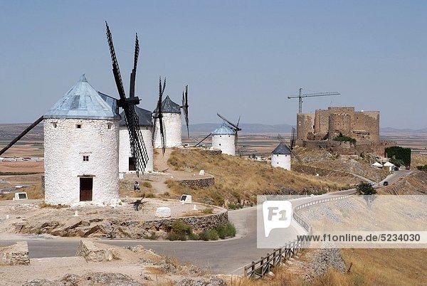 Mills and Castle Consuegra Consuegra background  Toledo  Castilla La Mancha  Spain