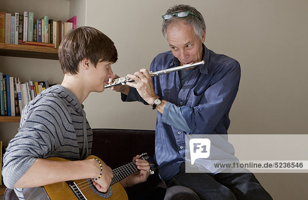 Father and son playing music together