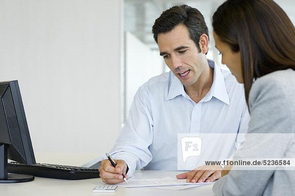 Financial advisor explaining document to client
