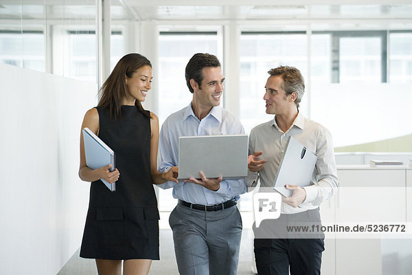 Business associates walking and talking together