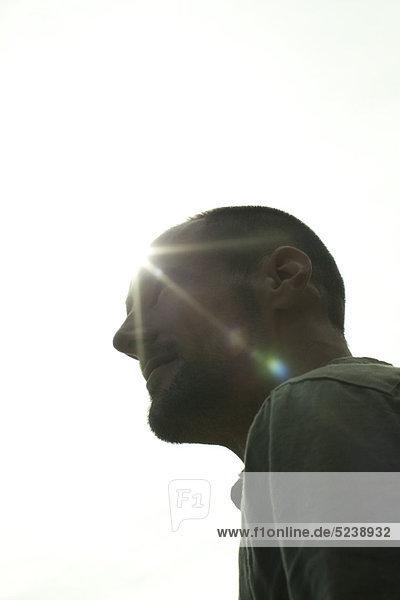 Mann von Sun  silhouetted Porträt