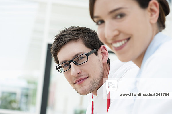 Germany  Bavaria  Diessen am Ammersee  Close up of two young doctors  smiling  portrait