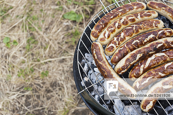 Belgium, Mechelen, Sausages on barbecue grill KJF000121