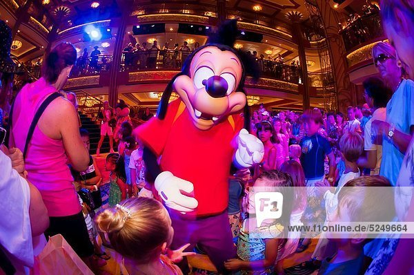Max Goof  Character dance party  in the lobby atrium on the new Disney Dream cruise ship sailing between Florida and the Bahamas
