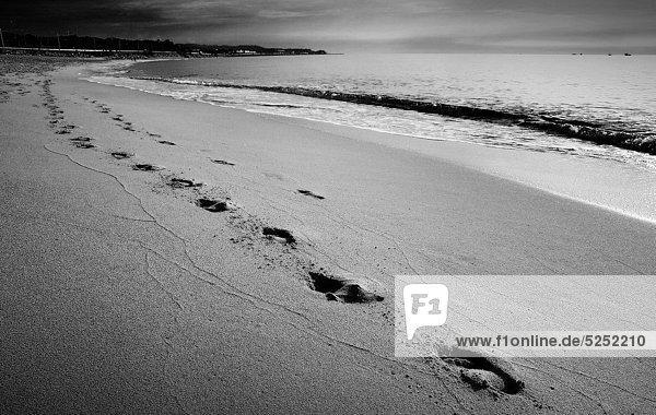 Footprints in the sand on the beach  Mataro  Catalonia  Spain