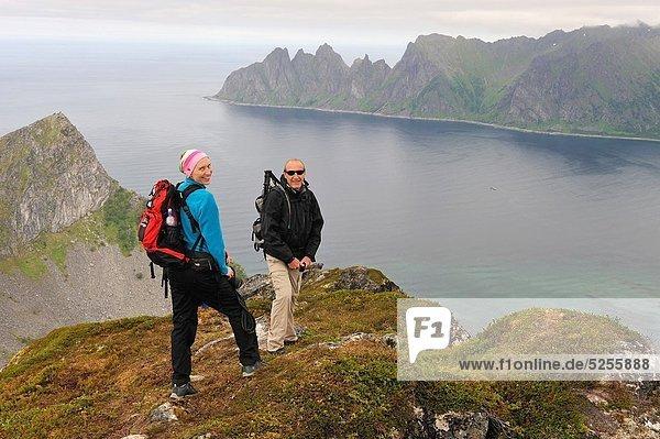 couple on Husfjellet mountain  Senja island County of Troms  Norway  Northern Europe