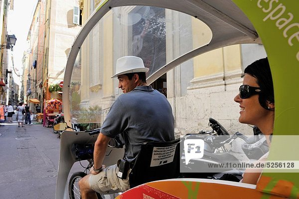 rickshaw in a street of the Vieux-Nice Nice  Alpes-Maritimes department  Provence-Alpes-Cote d´Azur region  southeast of France  Europe