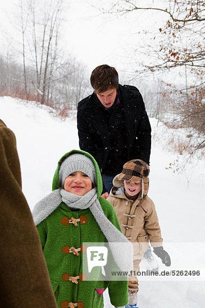Family walking in snow
