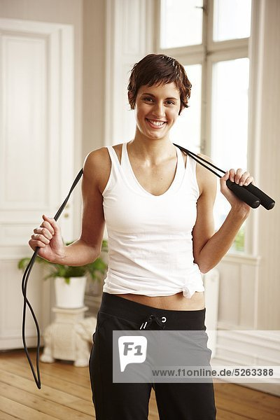 Woman holding skipping rope  portrait