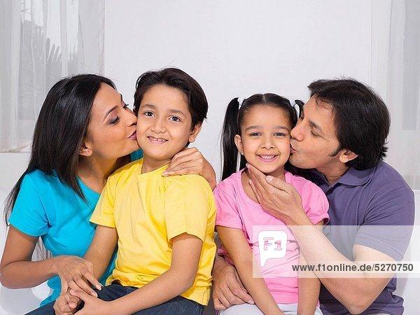 Parent kissing their children MR779P   MR779Q   MR779R   MR779S