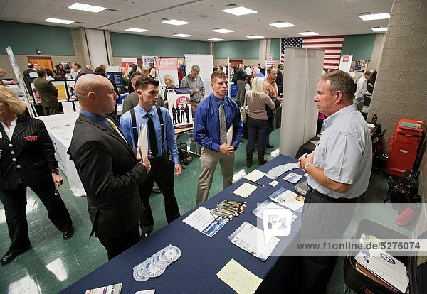 Grand Rapids  Michigan - John Berck right  director of admissions for the Great Lakes Maritime Academy  talks to military veterans about training for a maritime career during a job fair at the Army Reserve Center
