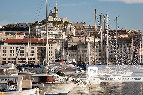 Boats and Yachts in the Vieux Port with the Baslique Notre Dame de la Garde Church in the Background  Marseilles  France