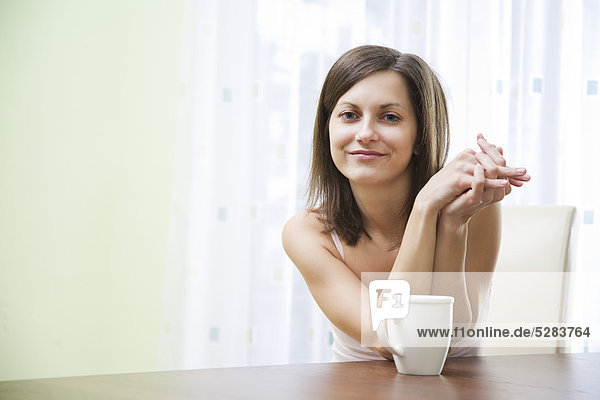 portrait of young woman with cup