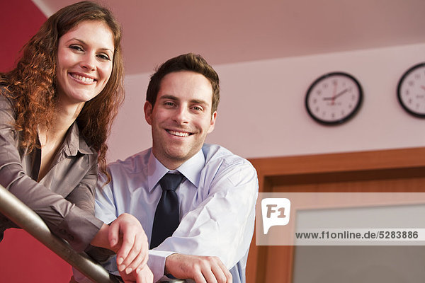 portrait of young businesswoman and male colleague