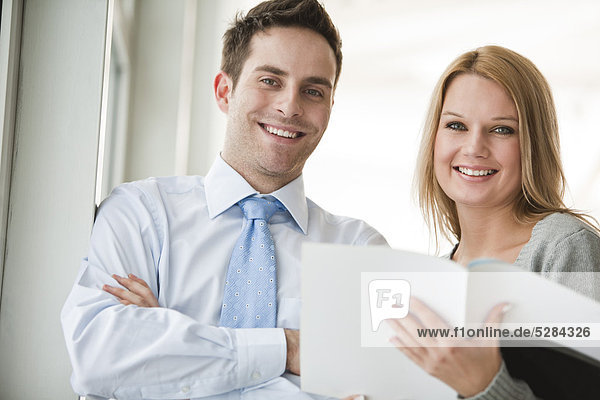 portrait of young businessman and female assistant