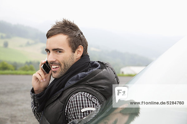 portrait of young man talking on mobile phone