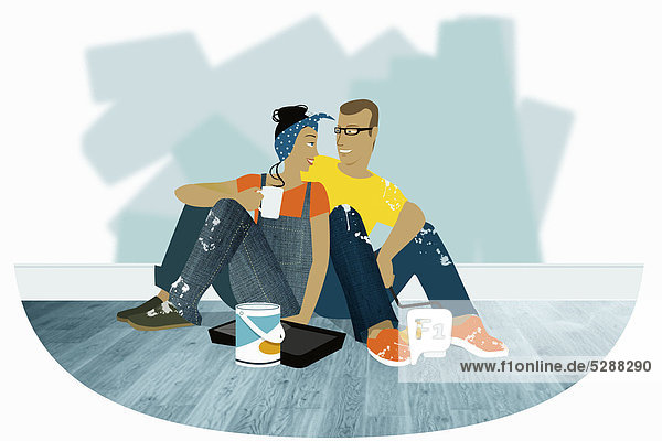 Couple relaxing while decorating new home