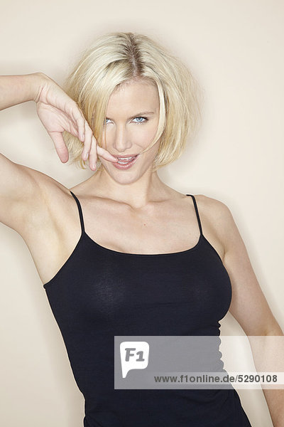 Beautiful mature blonde woman shaking hair