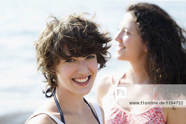 Women smiling together outdoors