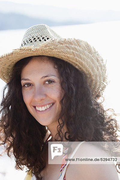 Close up of smiling woman wearing sunhat