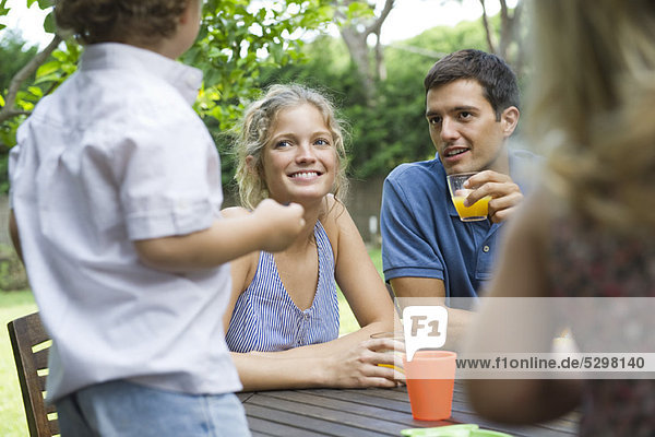 Family relaxing together at outdoor table