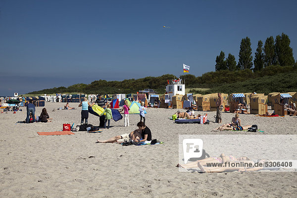 Tourists on the beach  Baltic Sea resort town of Timmendorf  Poel Island  Mecklenburg-Western Pomerania  Germany  Europe