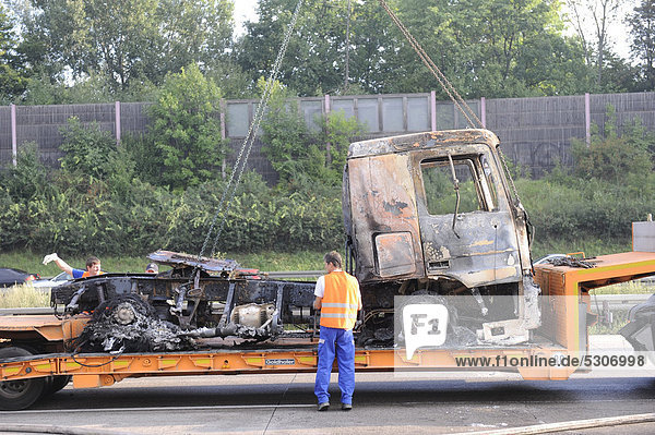 A burned-out truck engine on a flatbed truck for removal on the A8 motorway  Stuttgart  Baden-Wuerttemberg  Germany  Europe
