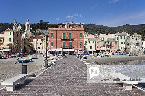 Pier  fishing boats on the beach  behind the church of San Matteo  Laigueglia  port town on the Ligurian coast  Riviera di Ponente  Liguria  Italy  Europe