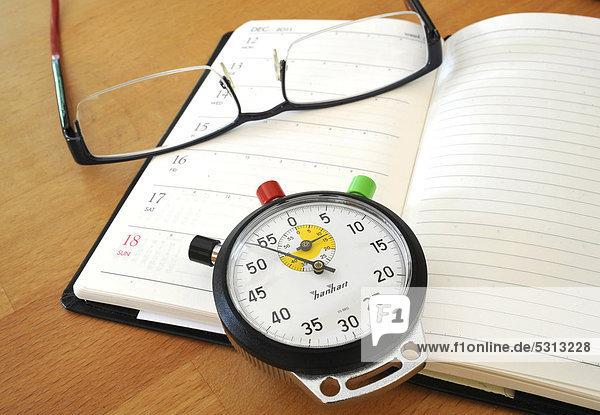 Stoppuhr  Terminkalender  Brille