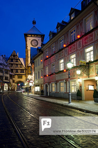 Schwabentor gate tower and Christmassy and snowy old town of Freiburg im Breisgau,  Black Forest,  Baden-Wuerttemberg,  Germany,  Europe
