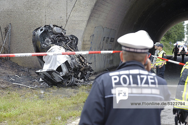 Wreckage of an Audi car  destroyed and burned out beyond recognition  after a violent collision against the pillar of a bridge  Sindelfingen  Baden-Wuerttemberg  Germany  Europe