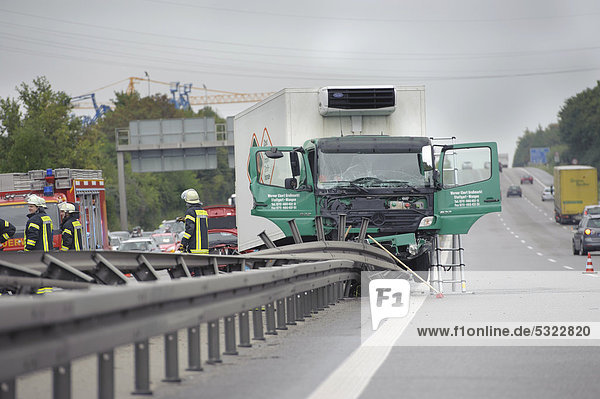 A 7.5 ton truck is stuck on the central reservation on the Autobahn A81  motorway  following a serious road traffic accident  Ludwigsburg  Baden-Wuerttemberg  Germany  Europe