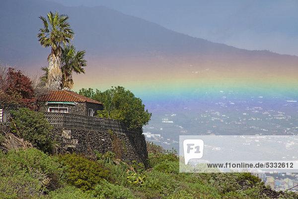 Europa Landschaft Kanaren Kanarische Inseln Atlantischer Ozean Atlantik La Palma Regenbogen Spanien Steinhaus