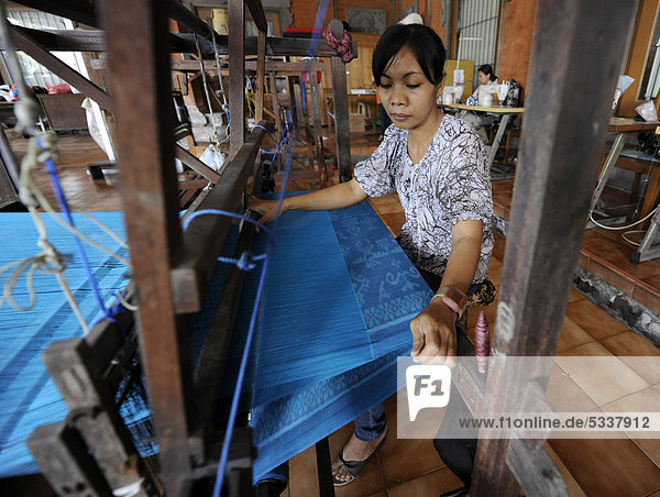 Woman working at a loom in Tenganan  Bali  Indonesia  Southeast Asia