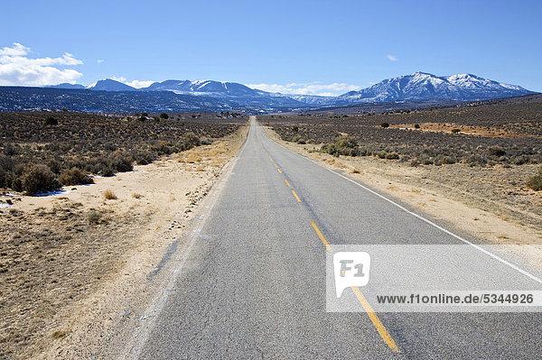 Utah Highway 211 looking towards La Sal Mountains just outside of Canyonlands National Park  Utah  USA  America