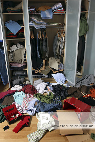 Scene of a burglary  ransacked closet  jewellery box cleared out  cash box forced open  documents sought through