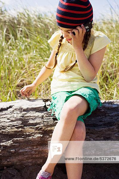 Girl on cellphone at beach