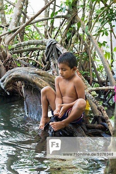 Guatemala  Rio Dulce  boy fishing in river