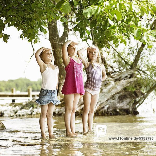 Smiling girls playing in lake