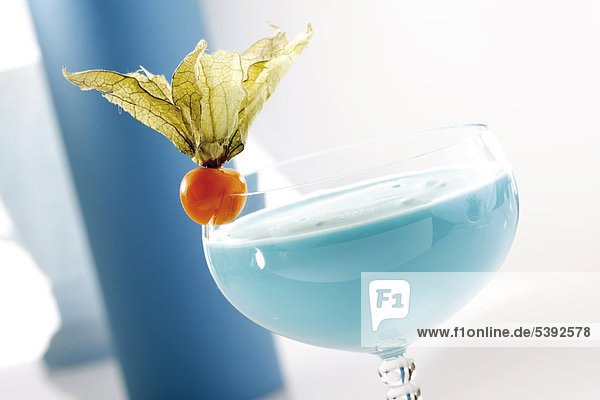 Blue Curacao cream liqueur garnished with cape gooseberry