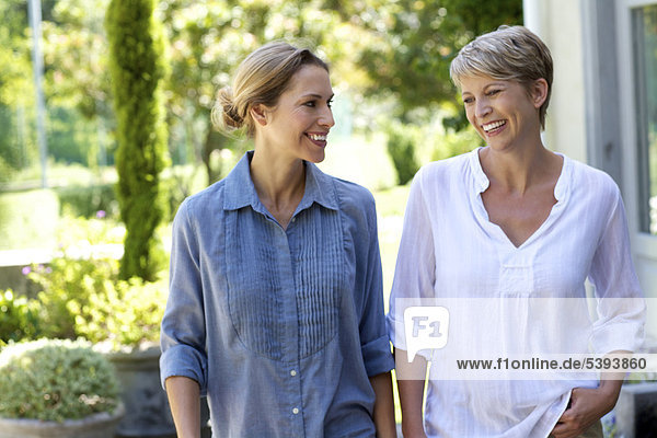 Two mature women walking together