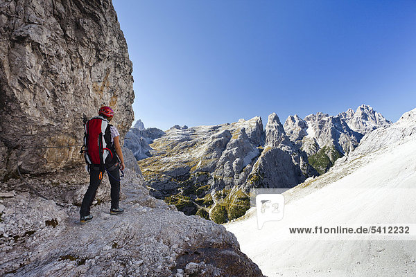 Climber at the Strada degli Alpini  view of Mt Cima Una  Mt Punta dei Tre Scarperi in the back  Sesto  Sexten  Alta Pusteria Valley  Dolomites  South Tyrol  Italy  Europe