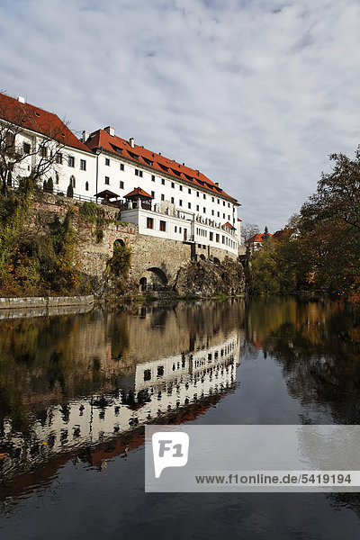Facade of the five-star Hotel Ruze  former Jesuit monastery  reflected in the Vltava river  Cesky Krumlov  UNESCO World Heritage Site  South Bohemia  Bohemia  Czech Republic  Europe