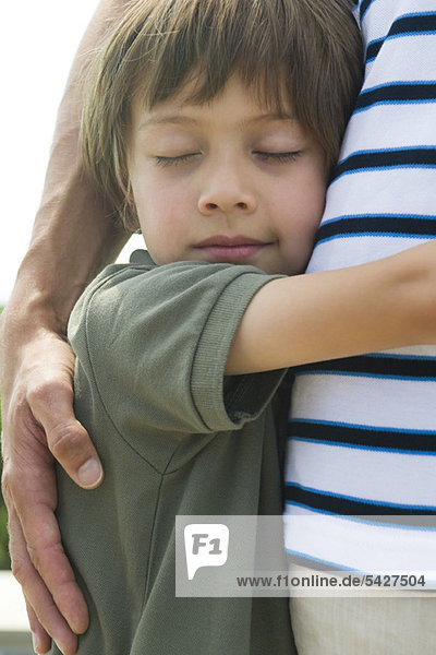 Boy embracing his father  close-up