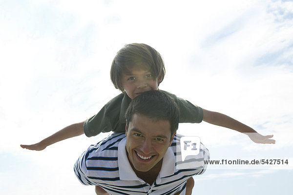 Father carrying son on back  portrait