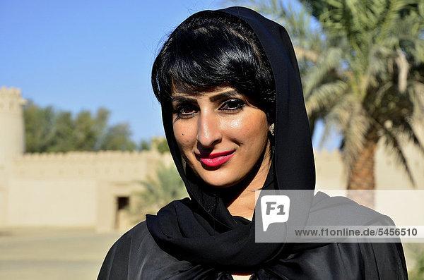 Native woman with veil in the Al-Jahili Fort of Al Ain  Unesco World Heritage Site  Abu Dhabi  United Arab Emirates  Arabian Peninsula  Orient  Asia