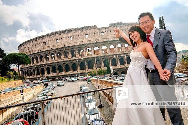 Bride and groom at the Roman Coliseum Rome Italy