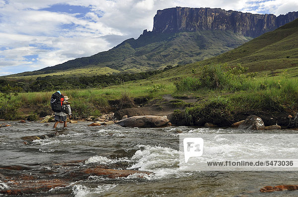 River crossing in front of the Kukunan table mountain  trail to the Roraima table mountain  highest mountain of Brazil  tri-border region Brazil  Venezuela  Guyana on the high plateau  South America
