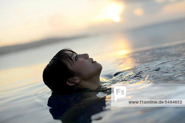 Young Asian woman relaxing in water